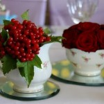 Cranberry Viburnum and red roses displayed in tea cups.