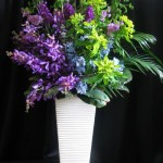 purple orchids blue delphinium green viburnum