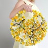 purse constructed out of yellow flowers