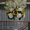 white and yellow flower arrangement