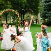 flower girls and wedding arch