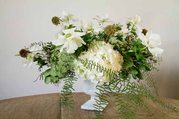 white flower arrangement in compote