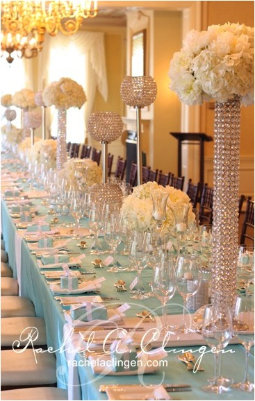 crystal vases with white flowers