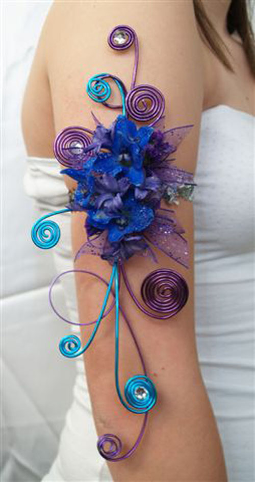 arm corsage with purple and blue flowers