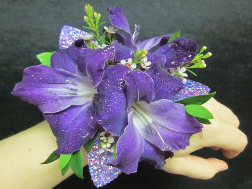 wrist corsage with purple flowers