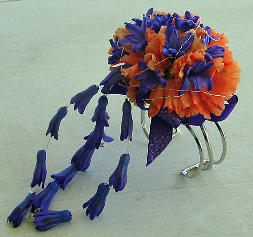 wristlet corsage with orange and purple flowers