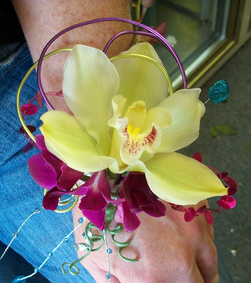 wristlet corsage with green orchid