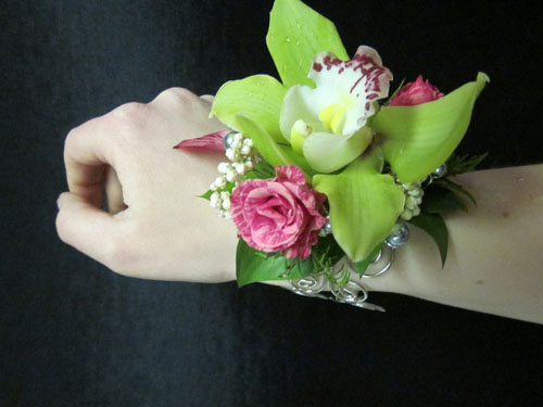 wrist corsage with green and pink flowers