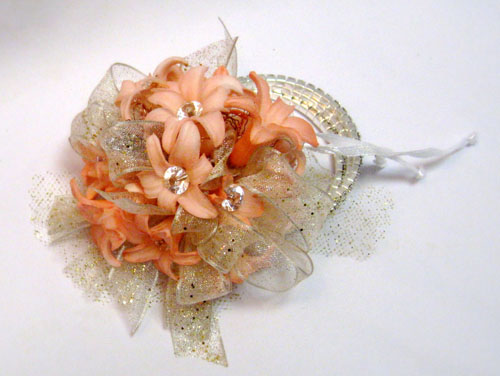 wrist corsage with peach hyacinth