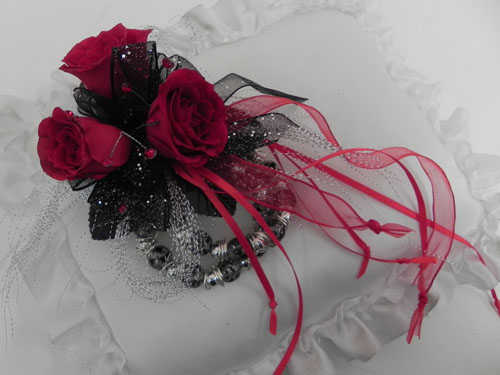 wristlet corsage with red and black