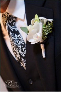 Designed by Laurie of Fleurie, Reedley, California. 1 Phalaenopsis floret 1 Stephanotis 1 Dendrobium bud  Seeded Eucalyptus Dusty Miller leaf Ribbon $20. (Photograph of Blessed Beyond Belief )