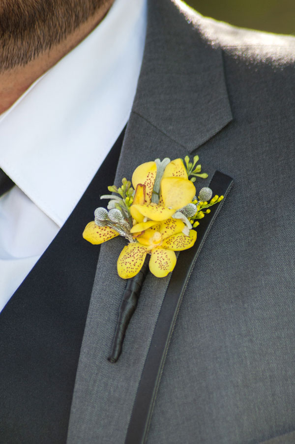 Designed by Shannon Cosgrove-Rivas of Flourish, California. 3 Yellow Aranda orchids Seeded Eucalyptus Solidaster Brezillia berry (sprayed silver) Dusty miller $18.50 (photo by Briggs Photography)