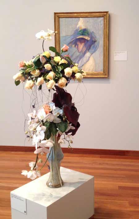 Floral Designer: Dianna Vigil, AIFD. Art Piece: Edmund Charles Tarbell, The Blue Veil