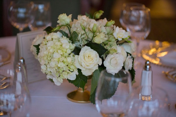 white flowers and gold container centerpiece