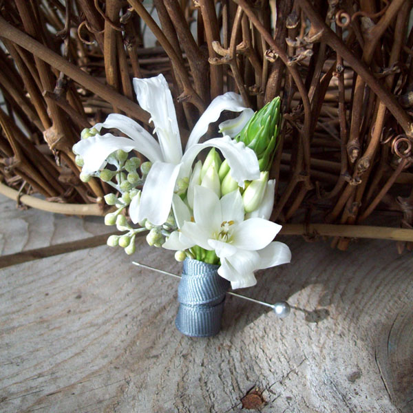 Designed by Holly of Sweet Pea Floral Design, Michigan. (www.sweetpfloral.com) Nerine lily Star of Bethlehem Seeded Eucalyptus Grey Grosgrain Ribbon Silver Boutonniere pin $17.50