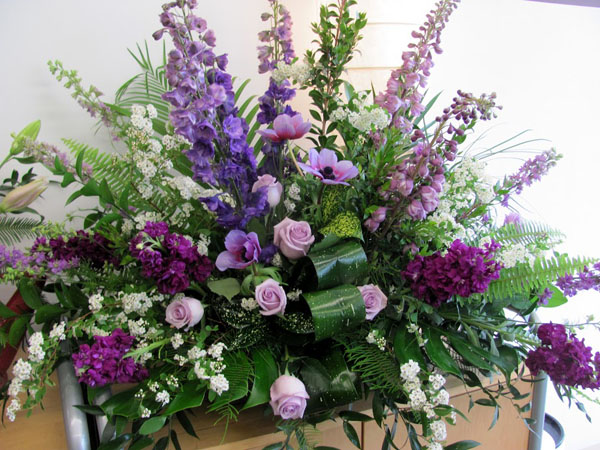 purple funeral flower spray