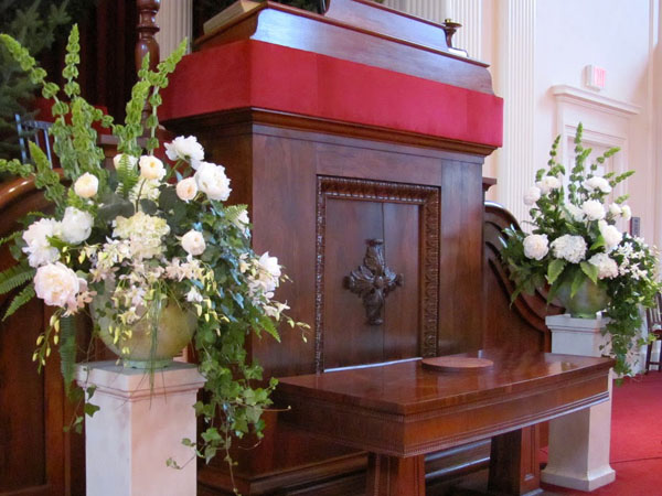 white flower arrangements on altar