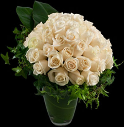 white flower arrangement of roses