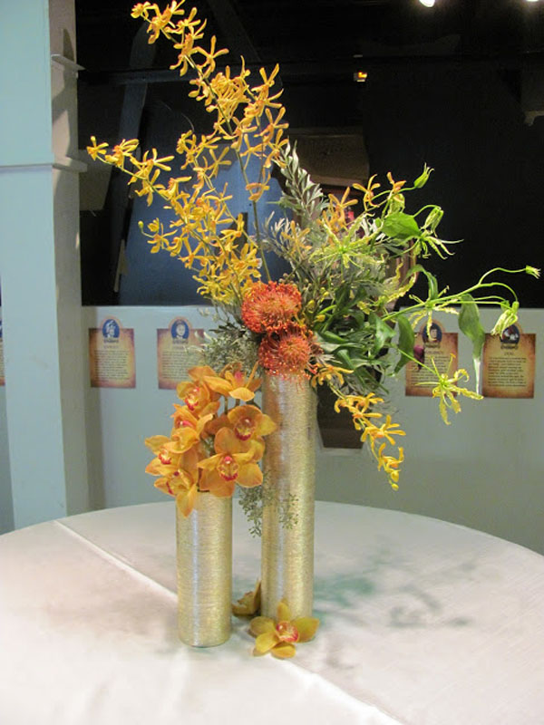 gold orchid arrangement