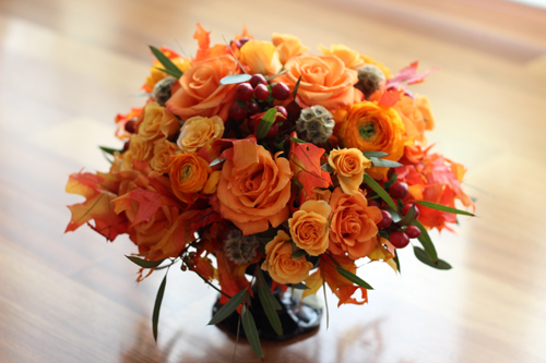 Orange fall flower centerpiece