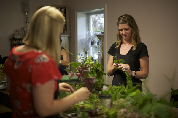 Mary and Megan designing woodland bridal bouquets