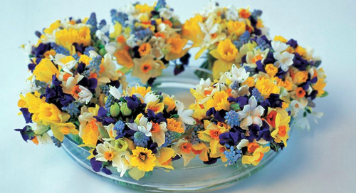 yellow and purple flower centerpiece