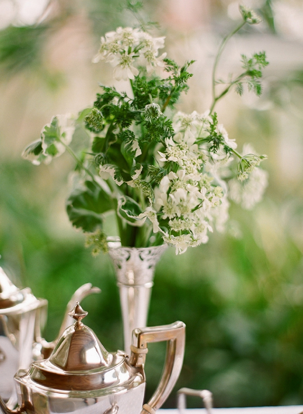 white and green in a silver vase