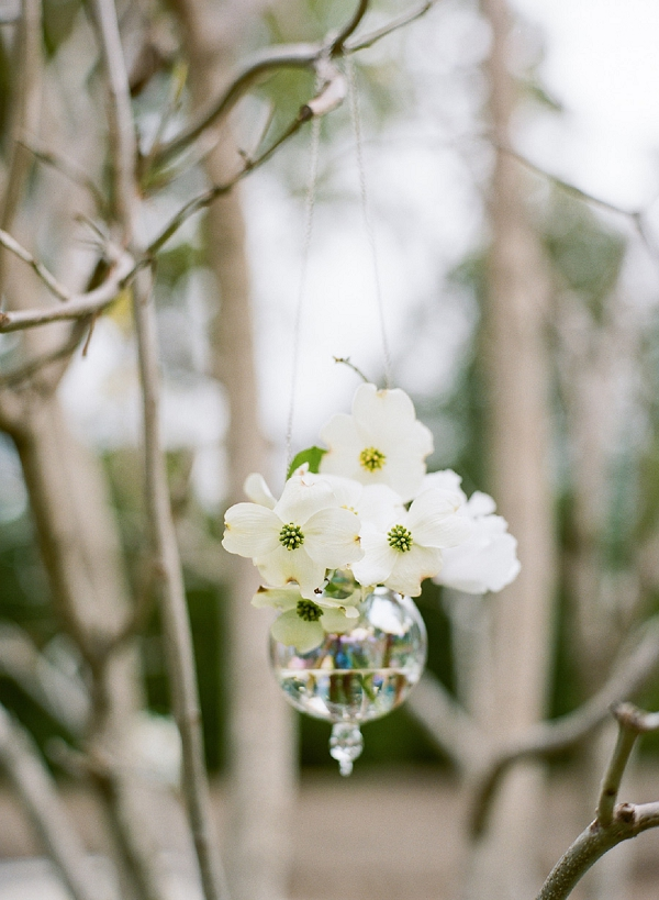 hanging flowers in a glass vase