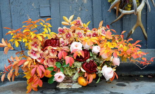 fall flowers with orchids peonies and persimmons
