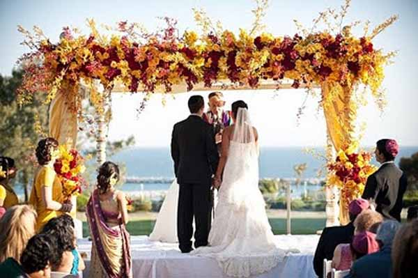 Mandap covered with red and yellow flowers