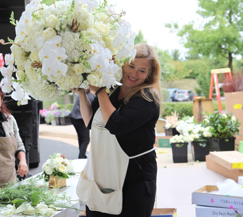 florist with big arrangement