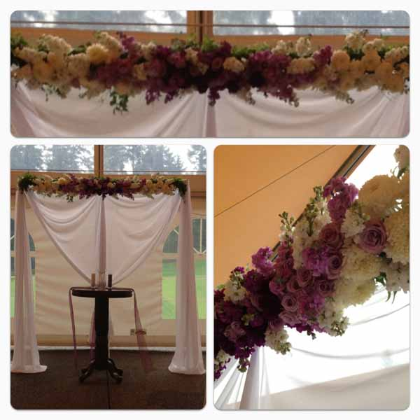 purple and white flower garland on chuppah