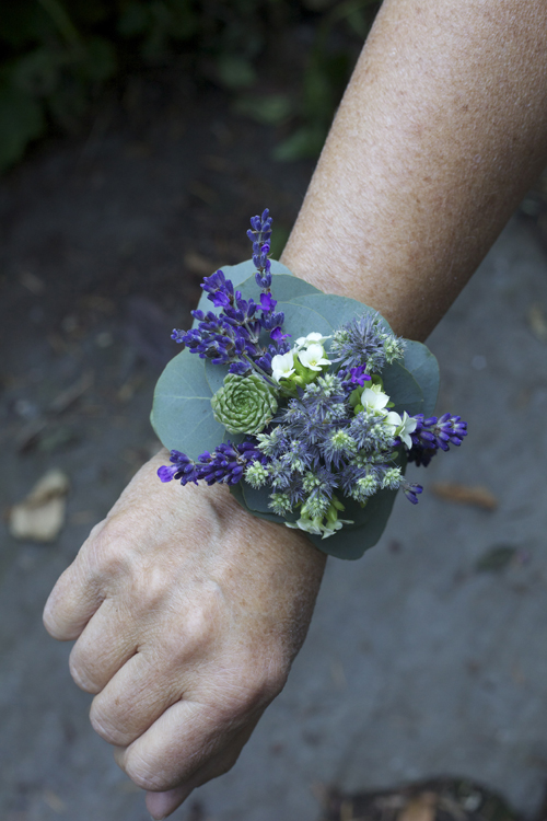 purple and green flower corsage