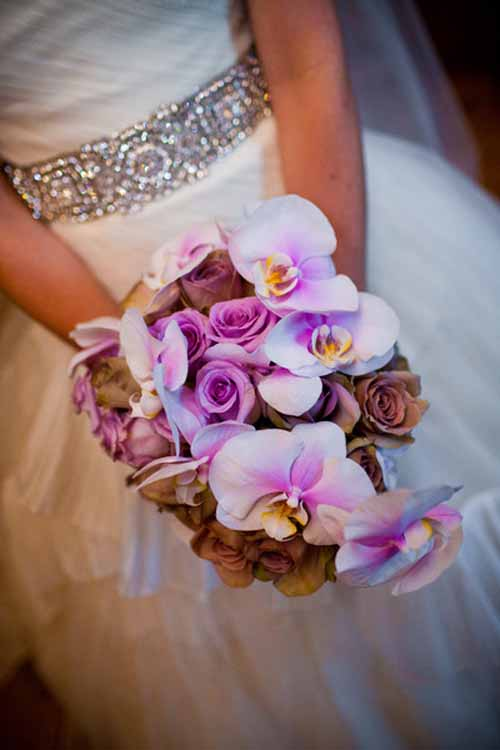 purple bridal bouquet with roses and orchids
