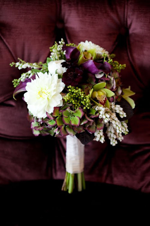 purple, green and white bridal bouquet with dahlias and pieris japonica