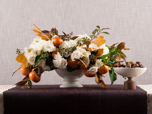white and orange flower centerpiece