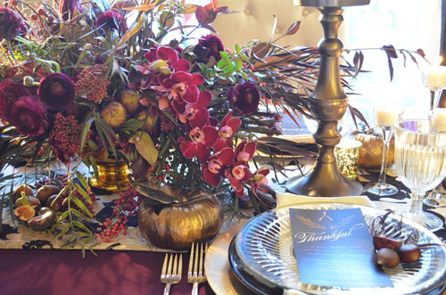 brown and burgundy fall flower arrangement