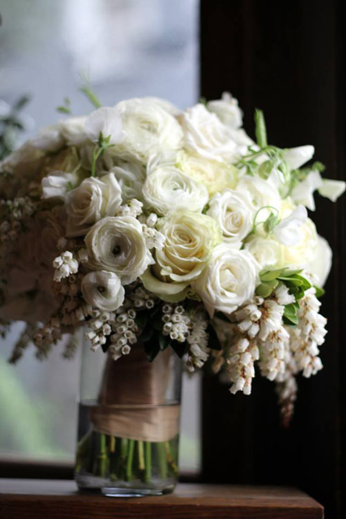 white ranunculus and pieris japonica bridal bouquet