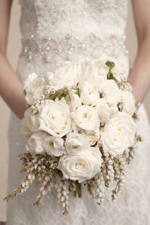 white rose, ranunculus and pieris japonica bridal bouquet