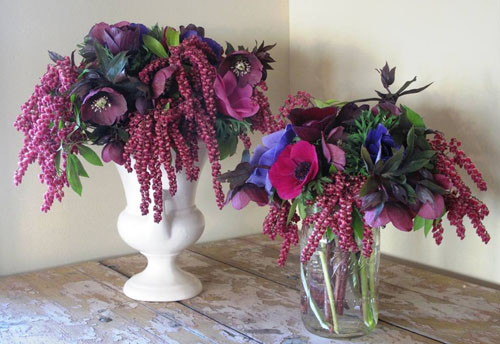 purple and magenta flower arrangements with anemones and pieris japonica