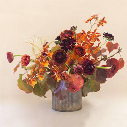 rusty orange flower centerpiece