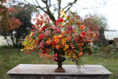 large fall flower display in urn