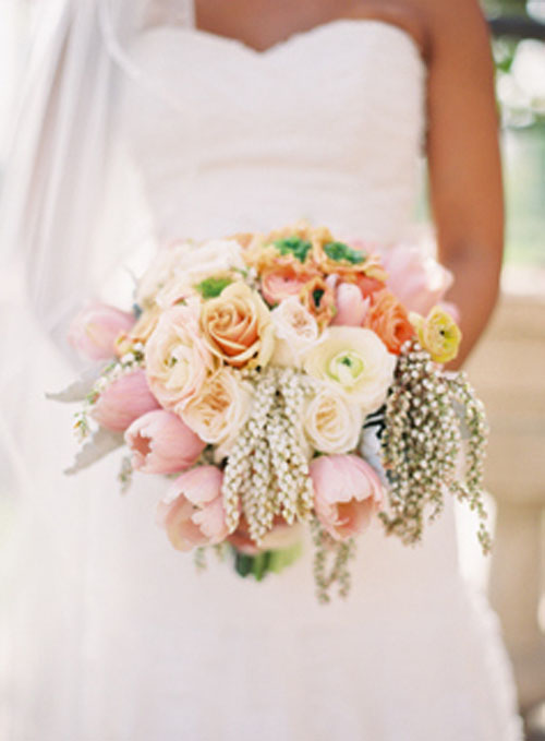 pink and ivory bridal bouquet with ranunculus and pieris japonica