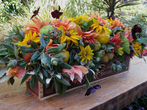 yellow, green and orange flower centerpiece