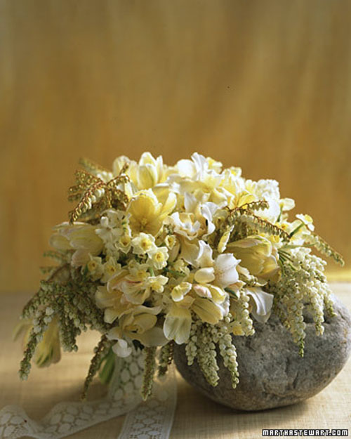 pale yellow and white spring bridal bouquet with pieris japonica and daffodils