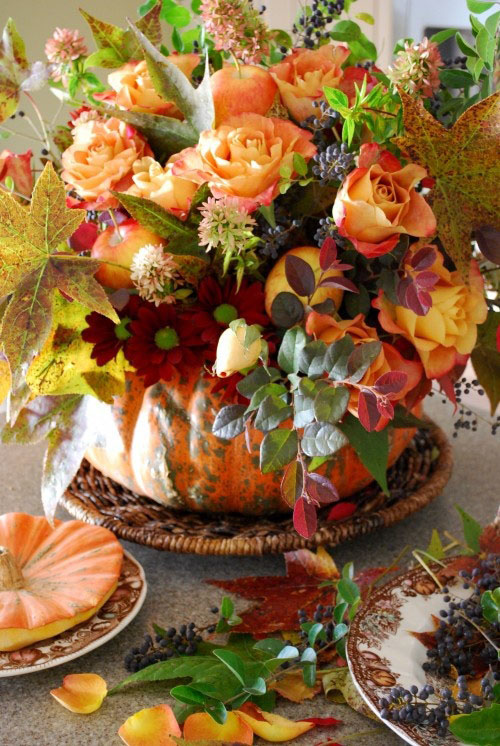 fall flowers in a pumpkin