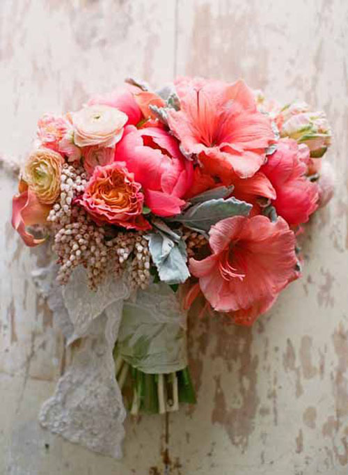 coral and grey bridal bouquet with amaryllis and pieris japonica