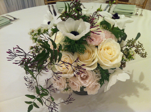 white centerpiece of garden roses
