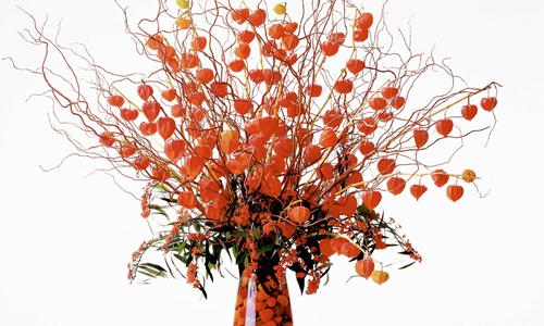 orange fall flower arrangement
