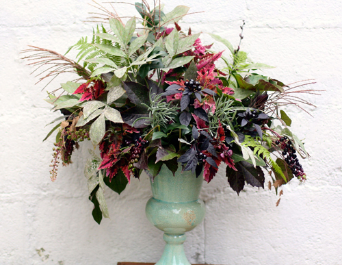 burgundy and green foliage arrangement
